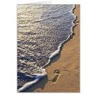 Tropical beach with footprints card