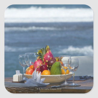 Tropical Fruits By The Ocean On Table 2 Square Sticker