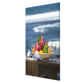 Tropical Fruits By The Ocean On Table Canvas Print
