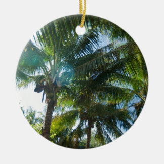 Tropical palms lit by the sun christmas ornament
