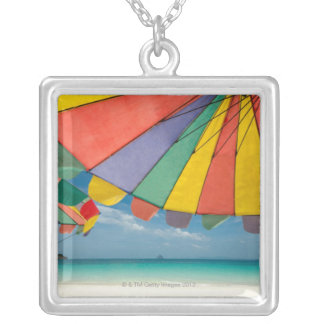 Tropical sand beach and turquoise sea. silver plated necklace