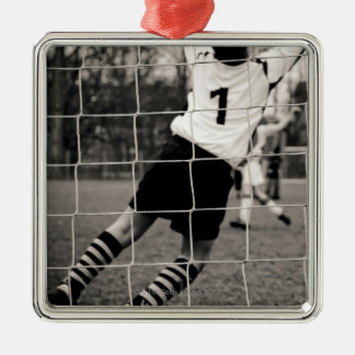 Trying to protect the team with the net in focus Silver-Colored square decoration