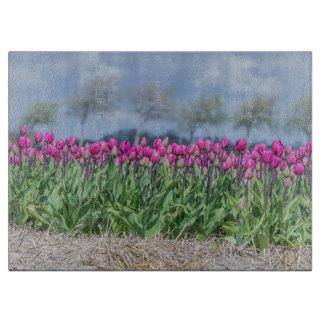 Tulips in a field in Holland glass Cutting Board