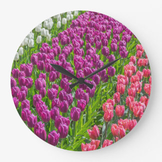 Tulips in three colours wall clock