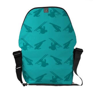 Turquoise ski pattern messenger bag