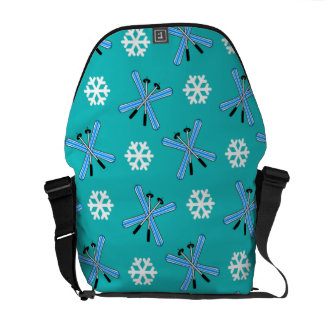 turquoise skis and snowflakes pattern courier bag