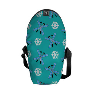 turquoise skis and snowflakes pattern messenger bag
