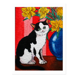 Tuxedo cat with daffodils in a blue vase postcard