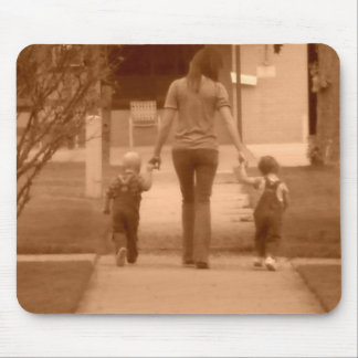 twins walking along sidewalk mouse mat