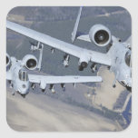 Two A-10C Thunderbolt II aircraft fly in format Square Sticker