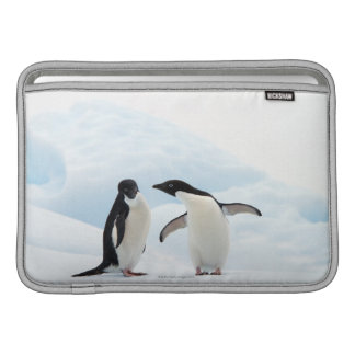 Two Adelie Penguins sitting on a sheet of ice MacBook Sleeve