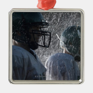 Two American football players in rain, side view Christmas Ornament