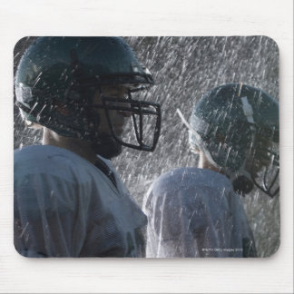 Two American football players in rain, side view Mouse Mat