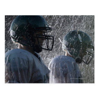 Two American football players in rain, side view Postcard
