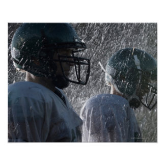 Two American football players in rain, side view Poster