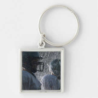 Two American football players in rain, side view Silver-Colored Square Key Ring