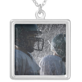 Two American football players in rain, side view Silver Plated Necklace