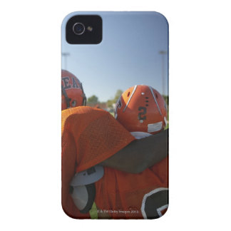 Two American football players looking at playing iPhone 4 Cover