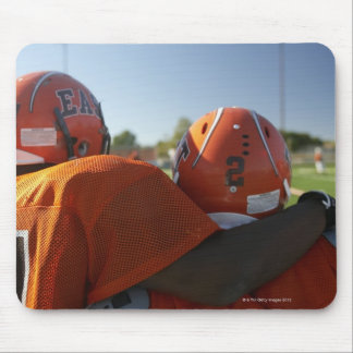 Two American football players looking at playing Mouse Mat