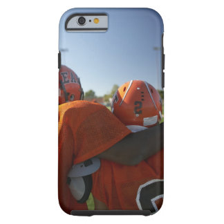 Two American football players looking at playing Tough iPhone 6 Case
