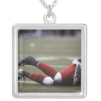 Two American football players lying on field, Silver Plated Necklace