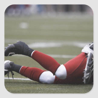 Two American football players lying on field, Square Sticker