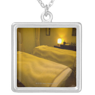 Two beds in the beauty salon, high angle view, silver plated necklace
