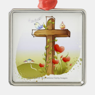 Two birds perching on a cross christmas ornament