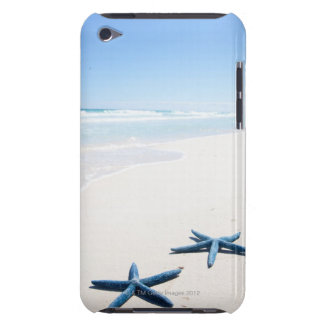 Two blue starfish at water's edge on tropical barely there iPod cases