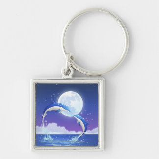 Two bottle-nosed dolphins jumping out of water key ring