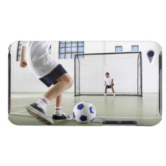 Two boys, aged 8-9, playing soccer in a school iPod touch case