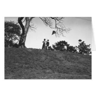 Two boys flying kite on hill B&W Card