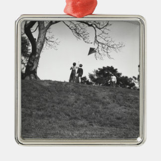 Two boys flying kite on hill B&W Silver-Colored Square Decoration