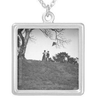 Two boys flying kite on hill B&W Silver Plated Necklace