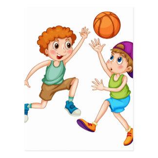 Two boys playing basketball postcard