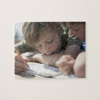 Two boys writing together jigsaw puzzle