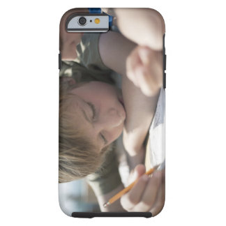 Two boys writing together tough iPhone 6 case