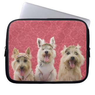 Two cairin terriers and one westie laptop sleeve