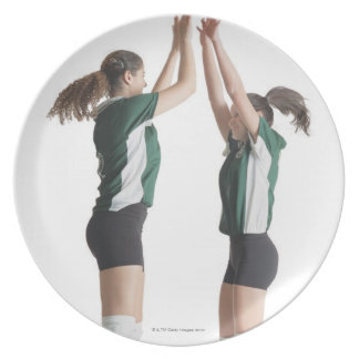 two caucasian female volleyball players from the party plates