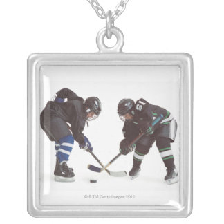 two caucasian hockey players wearing opposing silver plated necklace