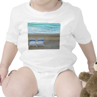 Two chairs on beach sand ocean waves baby bodysuit