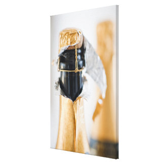 Two champagne bottles canvas print
