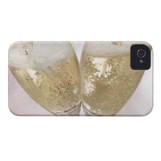 Two champagne flutes being filled with sparkling iPhone 4 case