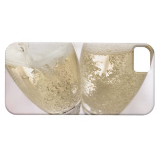 Two champagne flutes being filled with sparkling iPhone 5 covers