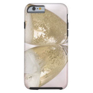 Two champagne flutes being filled with sparkling tough iPhone 6 case
