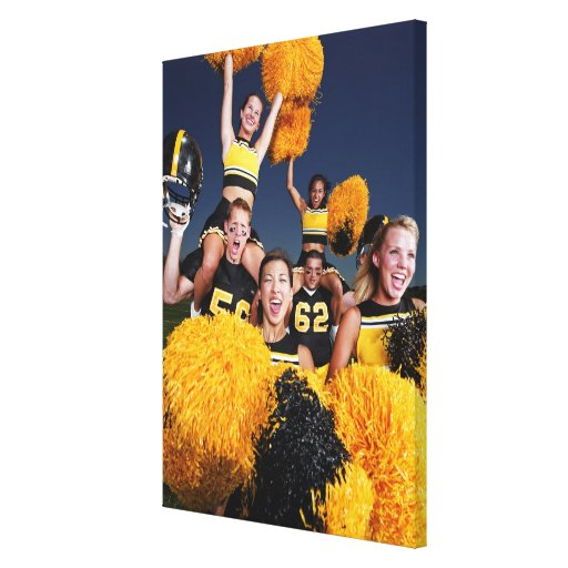 Two cheerleaders riding on shoulders of football canvas prints