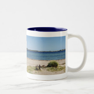 Two-colored cup blue beach and sea