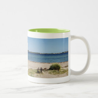 Two-colored cup green beach and sea