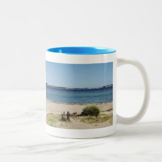 Two-colored cup light blue beach and sea