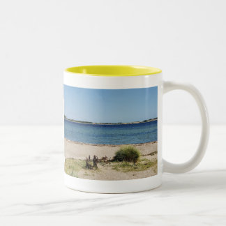 Two-colored cup yellow beach and sea